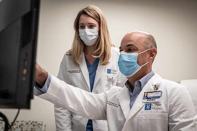 Oncologists Denise Mulholland and Moshe Faynsod are part of AccessHope, which connects employers with cancer specialists.