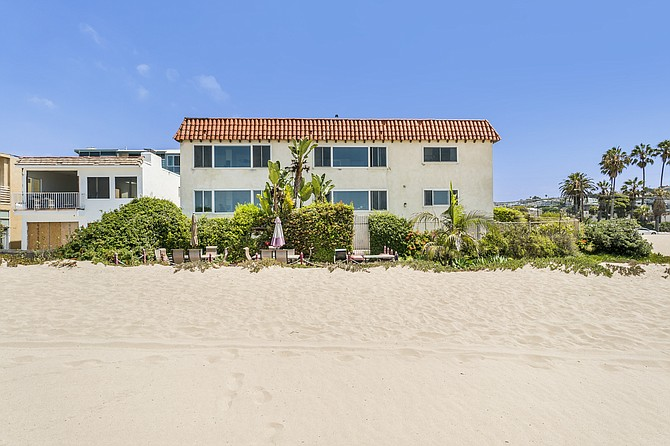The 15-unit property at 6615 Pacific Ave. has sand and ocean views.