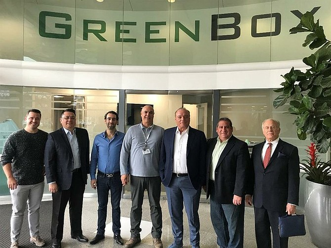 Last year, GreenBox welcomed Sigue Corporation top executives at the company's headquarters in San Diego. The group included Sigue's President Guillermo Vina.