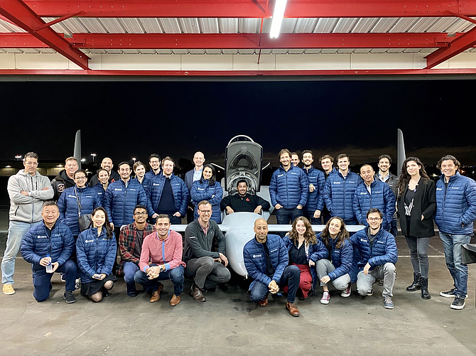 Starburst's global team at the Santa Monica Airport in 2019.