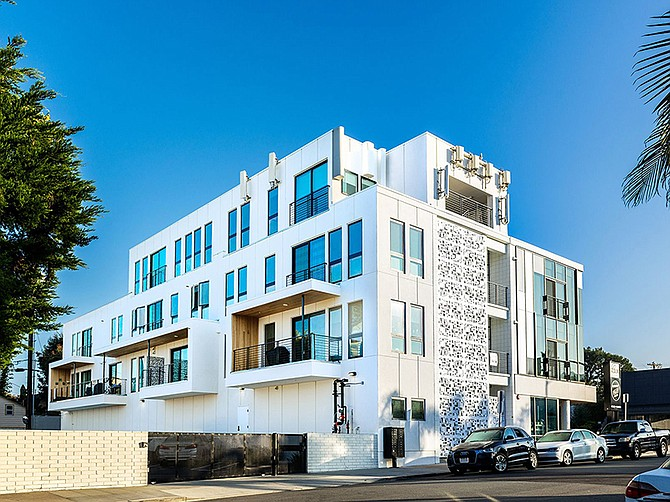Photo courtesy of Murfey Company. A former La Jolla medical office building was renovated into a mixed-use project that includes apartments, a market and a law office.