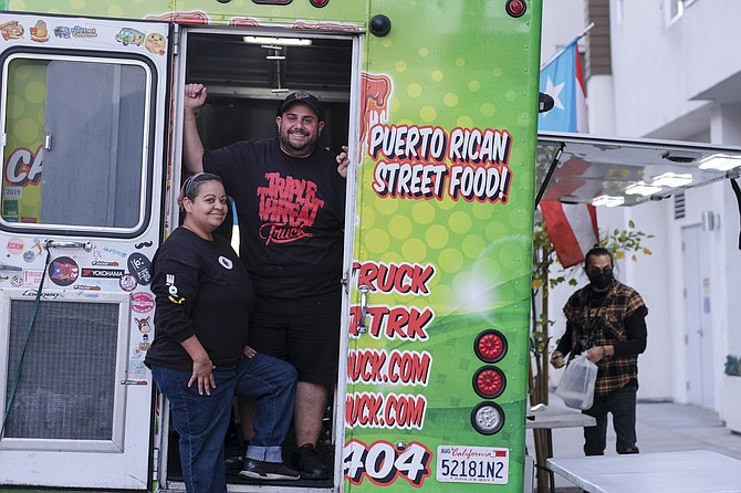 Triple Threat Truck co-owners Omayra and George Dakis (top left) said they've had fewer sales at their Puerto Rican food truck but customers are buying more — and tipping more — per order.