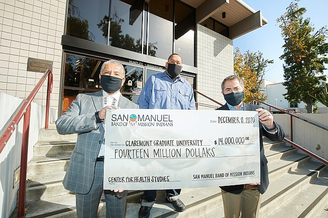 Claremont Graduate University Accepts $14 million check from San Manuel Band of Mission Indians for purchase of bookstore to convert to health studies center. San Manuel Chair Ken Ramirez (L), San Manuel Business Committee Member Johnny Hernandez (C) and CGU President Len Jessup (R)