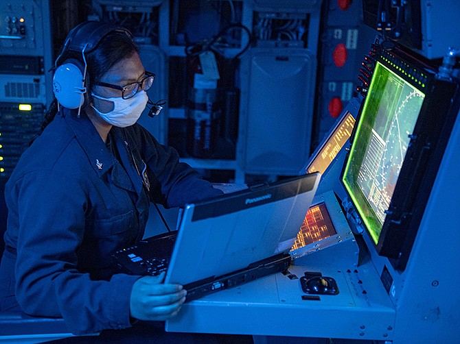 Photo courtesy of U.S. Navy. Fire Controlman (Aegis) 3rd Class Alexis Escobar stands watch as the radar systems controller in the guided-missile destroyer USS Mustin in the Philippine Sea. Lockheed Martin will do $1.9 million of support work related to the Aegis Weapon System in San Diego in the coming year.