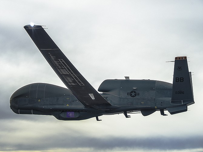 Photo courtesy of Northrop Grumman Corp. A Northrop Grumman Global Hawk carries an MS-177 sensor under its belly. Northrop Grumman will support the unmanned Global Hawk until 2030 under a newly awarded contract.