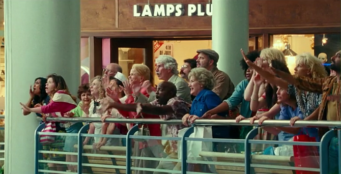 Scene from 'Wonder Woman 1984' in front of Lamps Plus store.