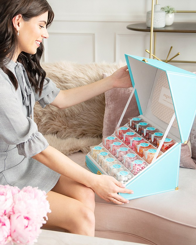Sugarfina candy is sold in pastel-colored plastic cubes.