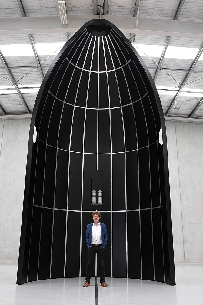Rocket Lab CEO Peter Beck with the company's new Neutron rocket.