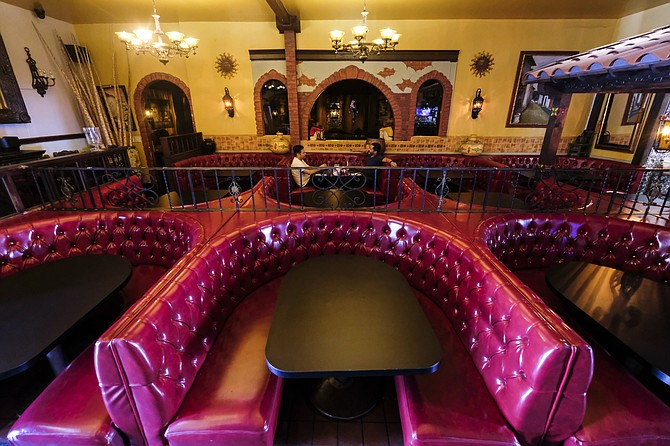 Indoor dining rooms, like El Compadre in Echo Park, are limited to 25% capacity.