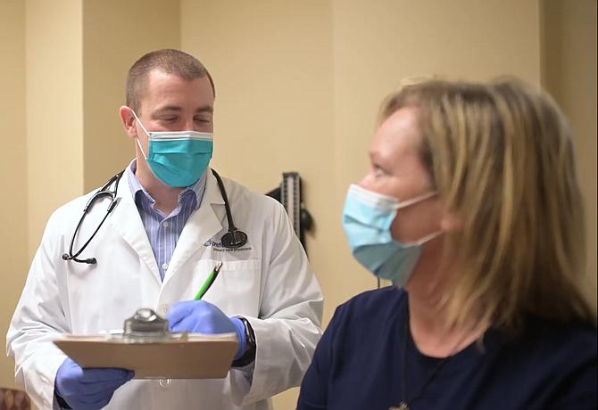 Kevin Kotar, an Agilon physician group doctor, visits a patient.