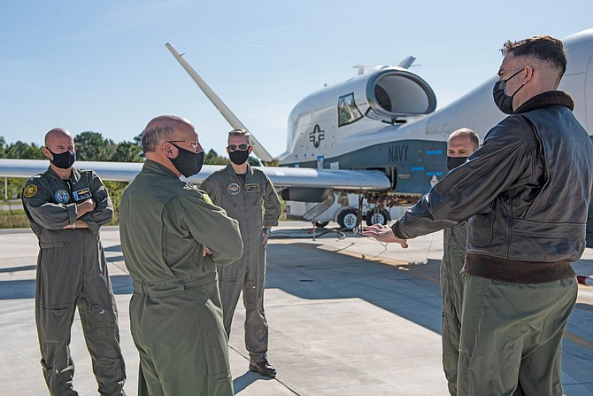 Adm. Mike Gilday, Chief of Naval Operations, second from left, receives a briefing on Northrop Grumman's MQ-4C Triton aircraft in November at Naval Air Station Patuxent River in Maryland. The Triton program is based in Rancho Bernardo.