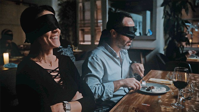"""Fever, a Madrid-based entertainment discovery platform, is bringing its """"Dining in the Dark"""" culinary activation to San Diego. Photo Courtesy of Fever."""