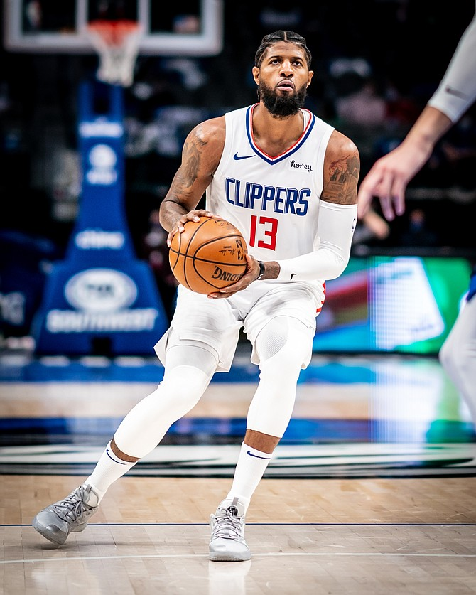 Paul George in a Clippers uniform with a Honey-sponsored patch.