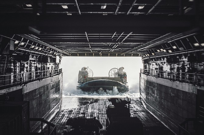 A view from inside the USS Portland shows a U.S. Navy landing craft entering its well deck. The Navy recently directed two contractors, Walashek Industrial & Marine and Epsilon Systems Solutions, to work on similar landing craft at Camp Pendleton. Photo courtesy of U.S. Navy.