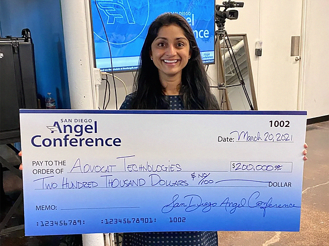 Advocat CEO Pradnya Desh holding the winning check which will be used for scaling her legal tech startup. Photo Courtesy of San Diego Angel Conference.