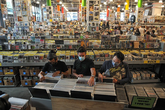 Customers shopping for records at Amoeba Music's grand reopening on April 1, 2021.