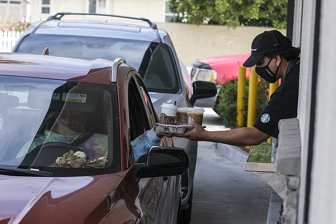 Starbucks plans to expand drive-thrus and curbside pickups.