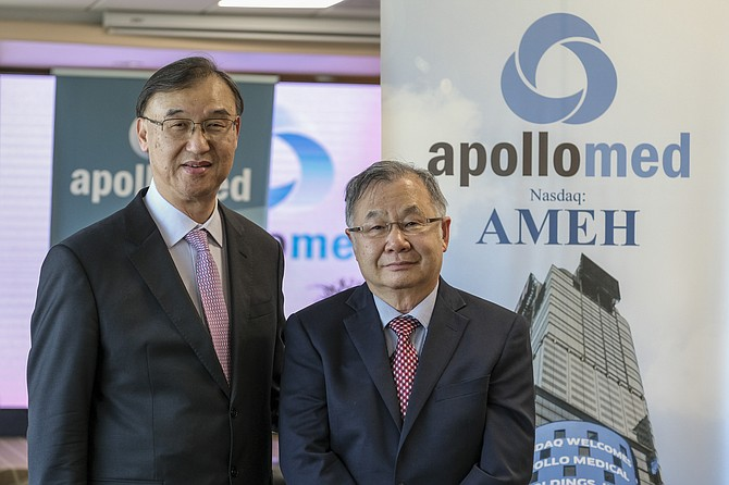Kenneth Sim, left, and Thomas Lam, co-chief executives of Alhambra-based Apollo Medical Holdings, which helps physician practices reduce medical costs and improve patient outcomes.