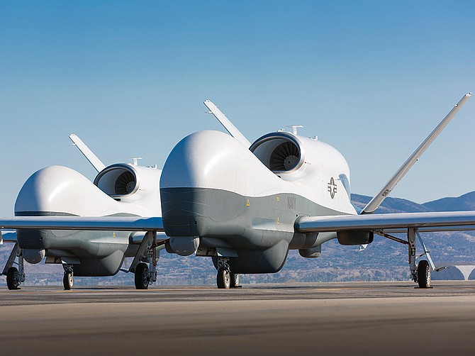 A pair of U.S. Navy MQ-4C Triton unmanned aircraft are shown in Palmdale, a short distance from where they were built. Northrop Grumman received an order for one Triton aircraft in late March. Photo courtesy of U.S. Navy.