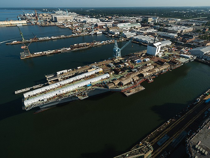 The aircraft carrier John F. Kennedy is being outfitted at the Newport News Shipbuilding division of Huntington Ingalls Industries in Virginia. At the time of the photo in November, the ship was 76% complete. Beneath the flight deck is the General Atomics Advanced Arresting Gear. Photo courtesy of Huntington Ingalls Industries.