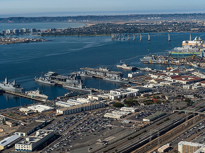 Manson Construction will replace one of the piers at Naval Base San Diego under a $101.4 million task order received on April 30. An aerial view from January shows the north end of the base, with the General Dynamics NASSCO and BAE Systems shipyards at right near the San Diego-Coronado Bridge. Photo courtesy of U.S. Navy.