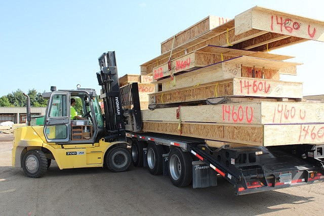 A US LBM forklift loading lumber. American Construction Source, owned by a pair of Santa Monica-based private equity firms, has agreed to combine with US LBM Holdings to become the second-largest privately held lumber and building materials business in the United States.