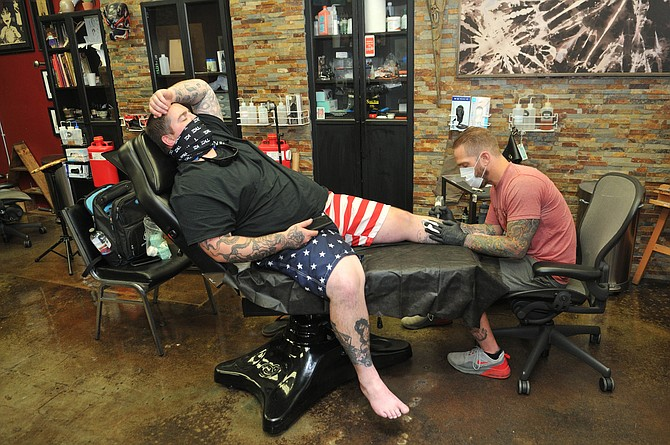 Paper Crane Tattoo parlor is prepping for a full reopening after losing 80% of its revenue last year.