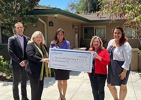 City National's Travis Van Treese, manager of San Diego Region Commercial Banking, Cilette Mitchell, Carlsbad branch manager and Maria Chan, nonprofit team lead, present a $10,000 donation to Nicole Ketcher, director of resource development and Cindy Taylor, president, board of directors of Operation HOPE-North County in Vista.