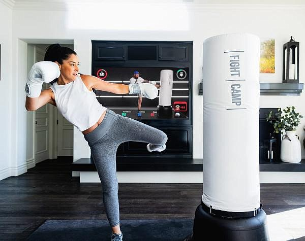 $1,219 for a free-standing bag, workout mat, boxing gloves, punch trackers and quick wraps