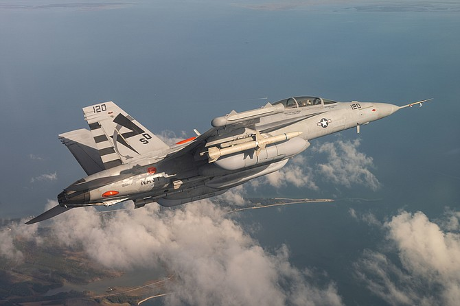 An EA-18G Growler plane conducts a Next Generation Jammer Mid-Band flight test.