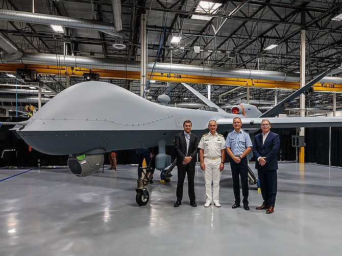 Photo courtesy of General Atomics Aeronautical Systems Inc.  General Atomics Aeronautical Systems Inc. hosted a roll-out event for the Royal Netherlands Air Force in early July, marking the completion of the country's first MQ-9A Block 5 remotely piloted aircraft. Seen on the factory floor are GA-ASI CEO Linden Blue (left) Vice Adm. Arie Jan De Waard, Lt. Gen. Dennis Luyt and GA-ASI President David R. Alexander.