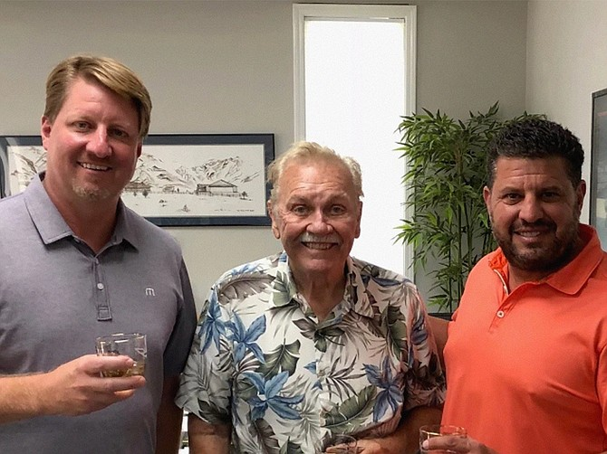Photo courtesy of Light Helmets. LIGHT Helmets COO Justin Bert, left, and CEO Nicholas Esayian, right, with founder Bill Simpson in Indiana.