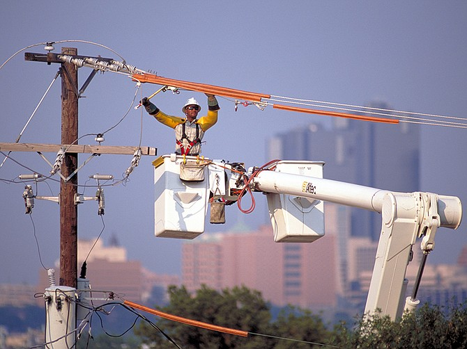 Photo courtesy of Sempra A specialist tends to power lines at Sempra's Texas utility, Oncor. Sempra plans to increase capital expenditures for the Texas utility, whose territory includes the Dallas, Fort Worth and Austin metro areas.