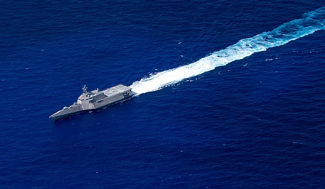 The Littoral Combat Ship USS Jackson, based in San Diego, transits the Pacific Ocean on Aug. 3. Three contractors received awards to sustain such ships during the next few years. Photo courtesy of U.S. Navy.