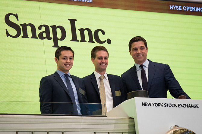 Snap co-founders Bobby Murphy (left) and Evan Spiegel (center) have seen the company's stock surge this year.