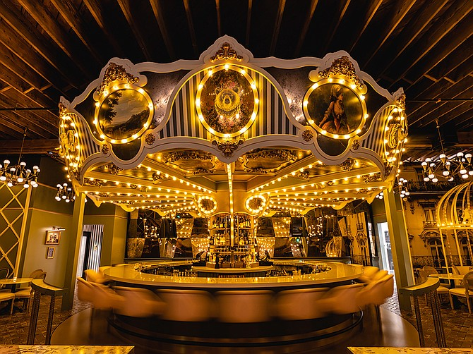 Photo Courtesy of Wolfie's Carousel Bar Wolfie's Carousel Bar, opened earlier this month, is a Parisian-themed food and beverage place that has a rotating bar in the center.