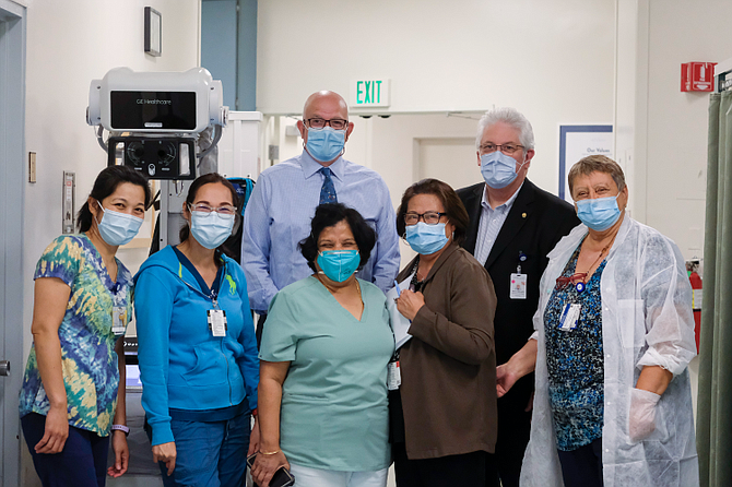 Pipeline's Andrei Soran and Memorial Hospital at Gardena Chief Executive Kevan Metcalf with (from left) Jocelyn Basilio, Mia Acuna, Mahua Biswas, Clemencia Hebron and Taliko Tuladhar.