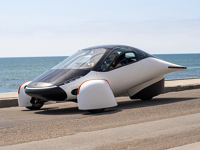 Aptera Motors' three-wheeled EV could theoretically run entirely off the energy produced by its solar panels. The business is exploring opening a factory. Photo courtesy of Aptera Motors Corp.