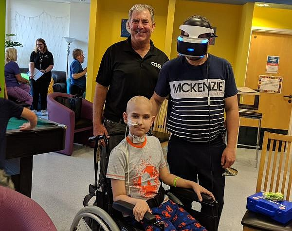 Jim Carol with a son and dad at Royal Manchester Children's Hospital in the UK