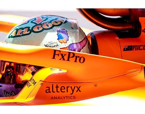 Alteryx name displayed on a McLaren Formula 1 race car