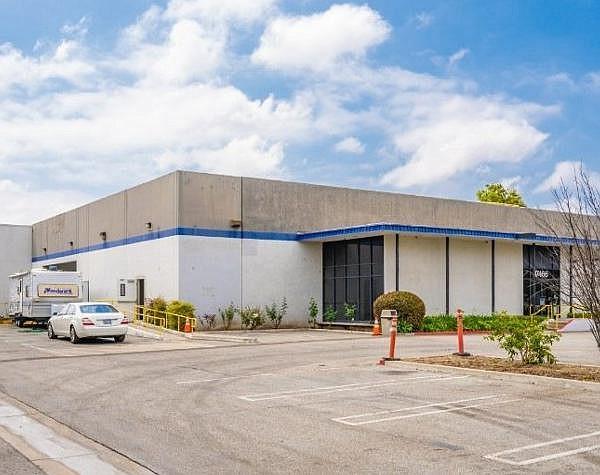 Full-building 40K-SF lease for ceramics division of dental company at 17466 Daimler St.