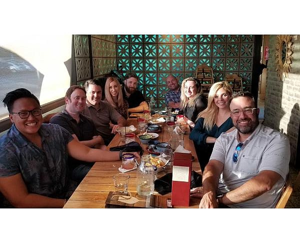 Pete Deutschman, far right, and his team at the Buddy Group enjoy a meal