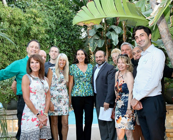 New Sherman Oaks Chamber Chief Victoria Bourdas Martinez, center, at a reception Tuesday evening with chamber directors and State Assemblymember Adrin Nazarian, center right.