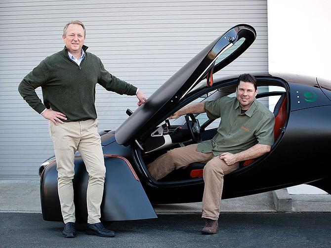 Photo courtesy of Aptera Motors Company co-founders Fambro and Anthony show off an Aptera prototype.